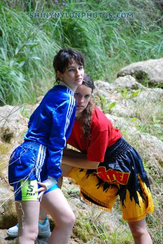 Jumping into the lake in Blue sprinter nylon shorts and black shiny muay thai sh