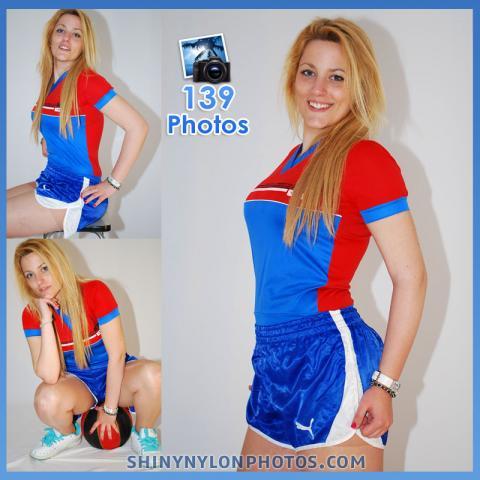 Blue nylon Puma shorts and red and blue nylon t-shirt.