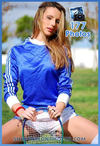 White puma shiny shorts and blue t-shirt
