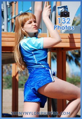 Blue shiny nylon shorts and blue lycra t-shirt