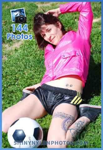 Black adidas sprinter shorts and pink jacket