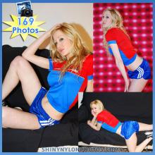 Blue nylon Sprinter shorts and red and blue nylon t-shirt.