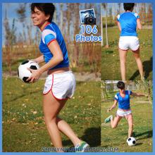 White adidas nylon shorts and blue t-shirt