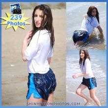 Wetlook in Dark Blue nylon Puma shorts and white t-shirt.