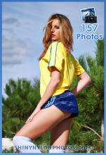 Shiny nylon darkblue shorts and yellow t-shirt