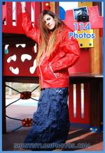 Shiny nylon darkblue long skirt and red k-way rainjacket