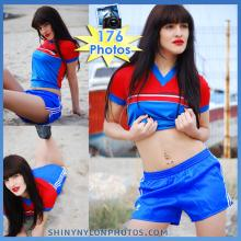 Blue nylon shorts and red nylon t-shirt.